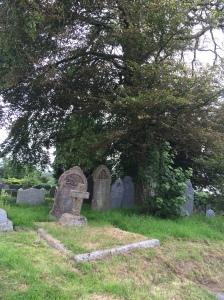 A quiet corner in the graveyard of St Bridget's Church, Bridgerule.  Photo source: Adventures In Biography